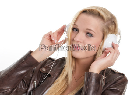 young blonde girl with headphones