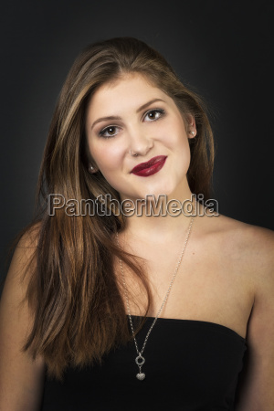 woman face with lipstick on black