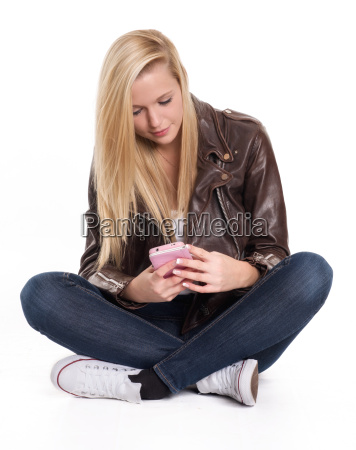 young blonde girl sitting on the