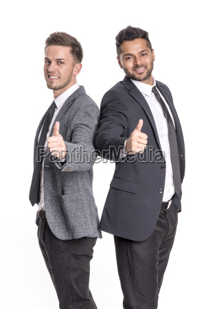 2 young entrepreneurs showing thumbs up