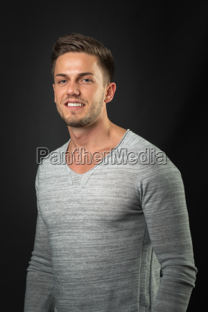 man in sweatshirt on black background