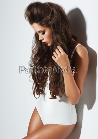 young woman with beauty long curly