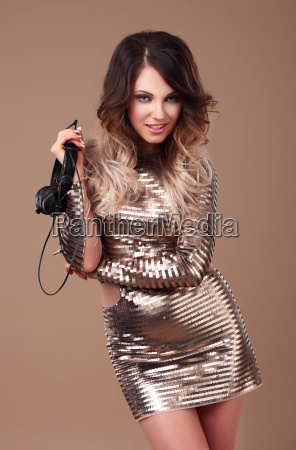 woman in dress with headphones