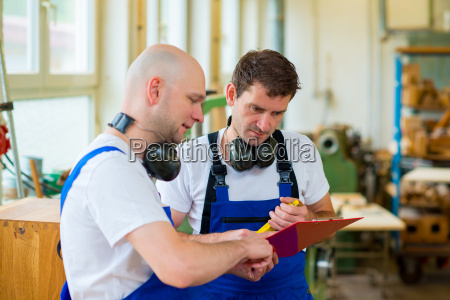 two worker in a carpenters workshop
