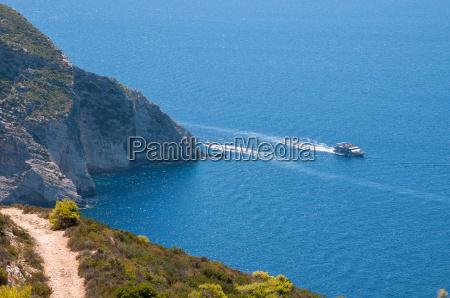 tourist ship at the cliff coast