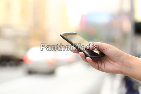 woman hand texting on a smart