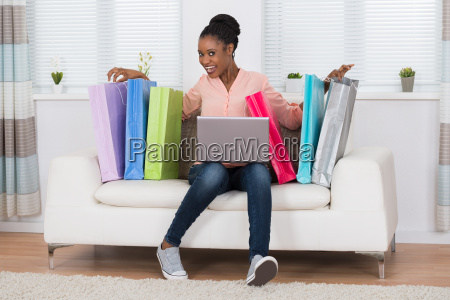 excited woman sitting on sofa with