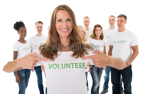 happy woman showing volunteer text on