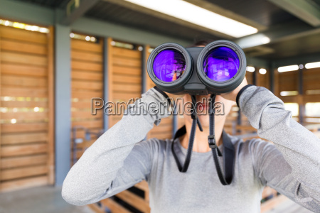 young woman use of the binoculars