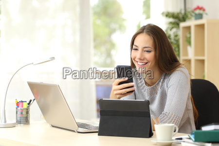 woman using multiple devices at home
