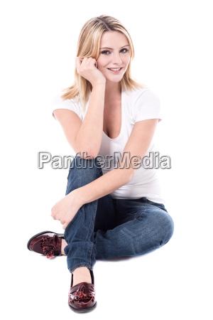pretty woman sitting on the floor