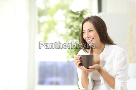 woman drinking coffee or tea at