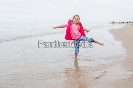 three year old girl having fun