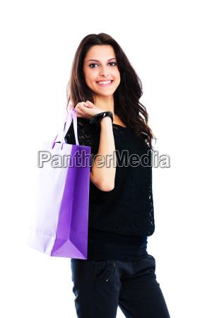 junge frau mit einkaufstasche isoliert auf