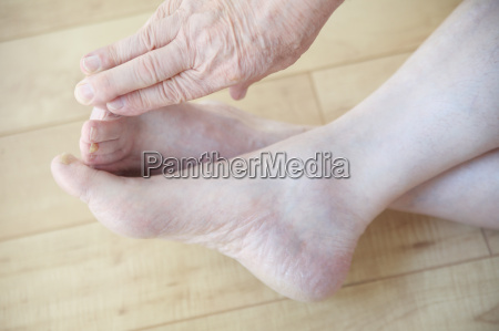 mature man reaching for toes