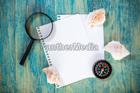 magnifying glass and empty paper sheet