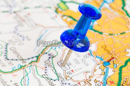 pushpin on a tourist map