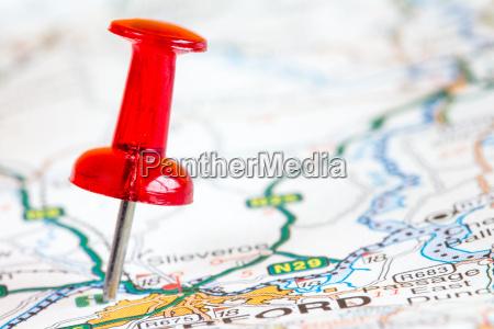 red pushpin on a tourist map