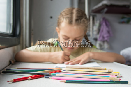 pencils in the foreground in the