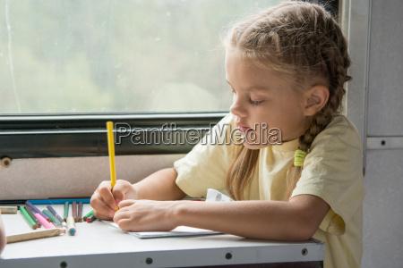 six year old girl draws pencils