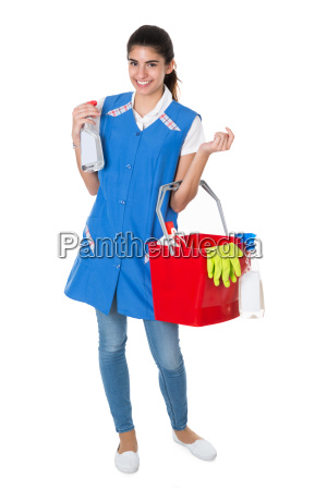 happy female worker carrying bucket with