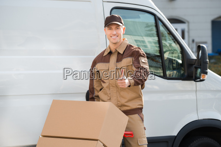 confident delivery man pushing parcels on