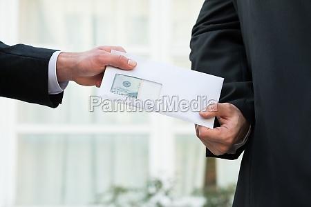 businessman receiving bribe from partner