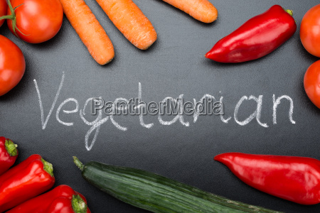 vegetarian written amidst fresh vegetables on