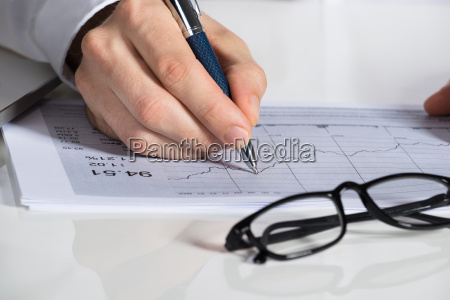 businessman preparing financial chart at desk
