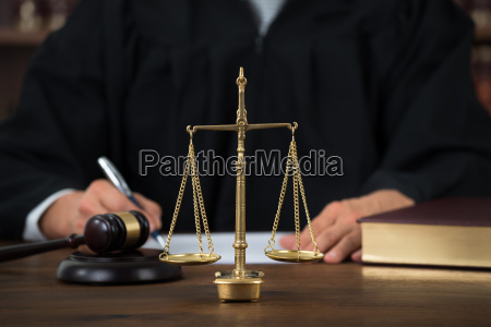 law scales on table with judge