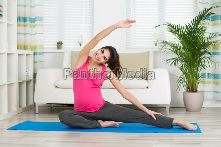 pregnant woman doing stretching exercise