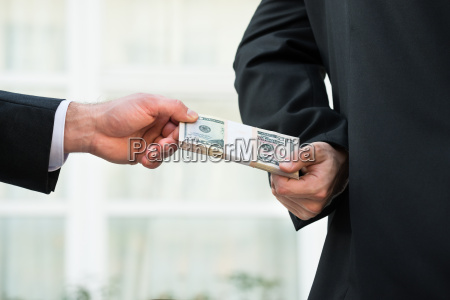 businessman taking bribe from partner