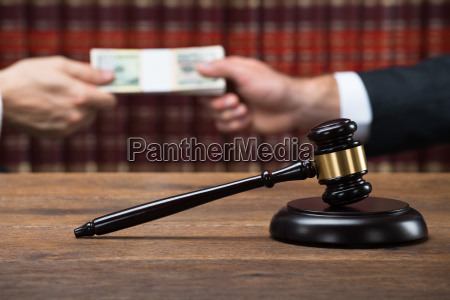 gavel on table with judge taking