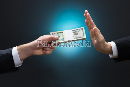 businessman refusing to take bribe from