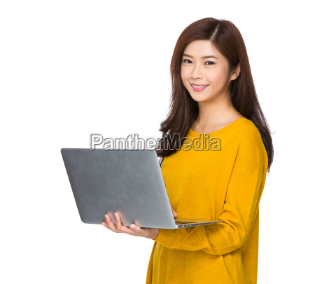 asian woman use of the notebook