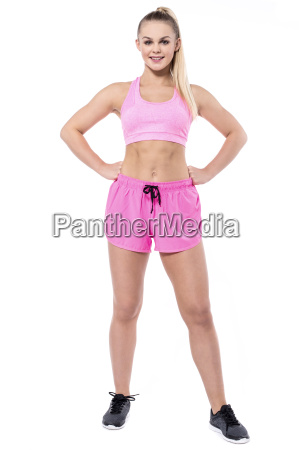 full length pose of young trainer