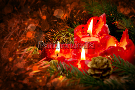four red candles with christmas ball