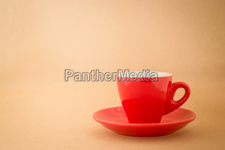 beautiful red cup of coffee on