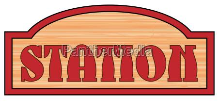 wooden station sign