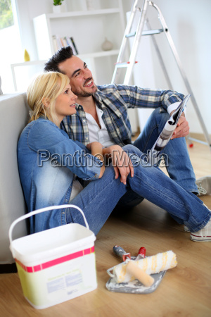 couple sitting on the floor choosing