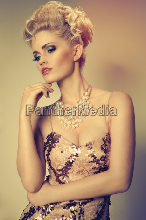 attractive blonde woman in evening dress