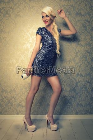 attractive blond woman in short sequin