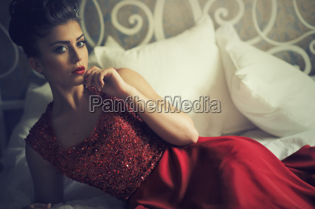 attractive brunette woman in elegant red