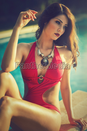attractive brunette woman in red swimsuit
