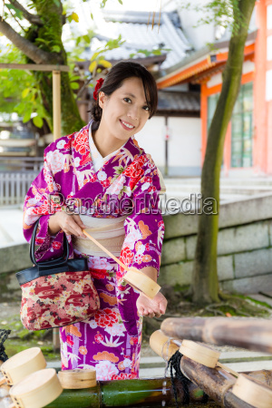 japanese woman washing hand before entering