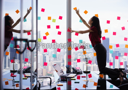 busy person attaching many sticky notes