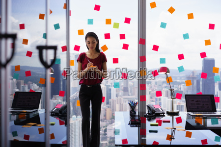 busy person writing many sticky notes