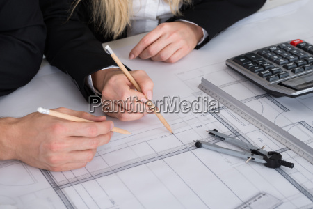 business people discussing a architectural drawing