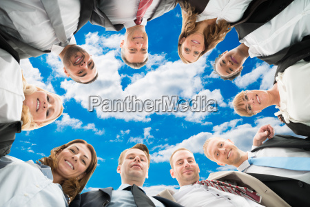 diverse business people forming huddle against