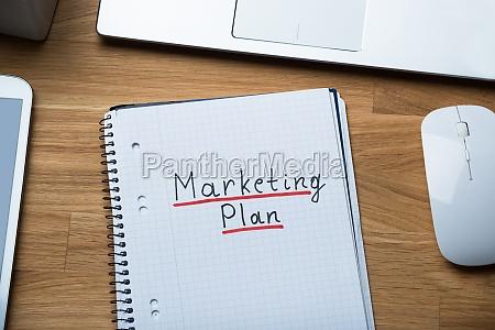 marketing plan written on notepad at